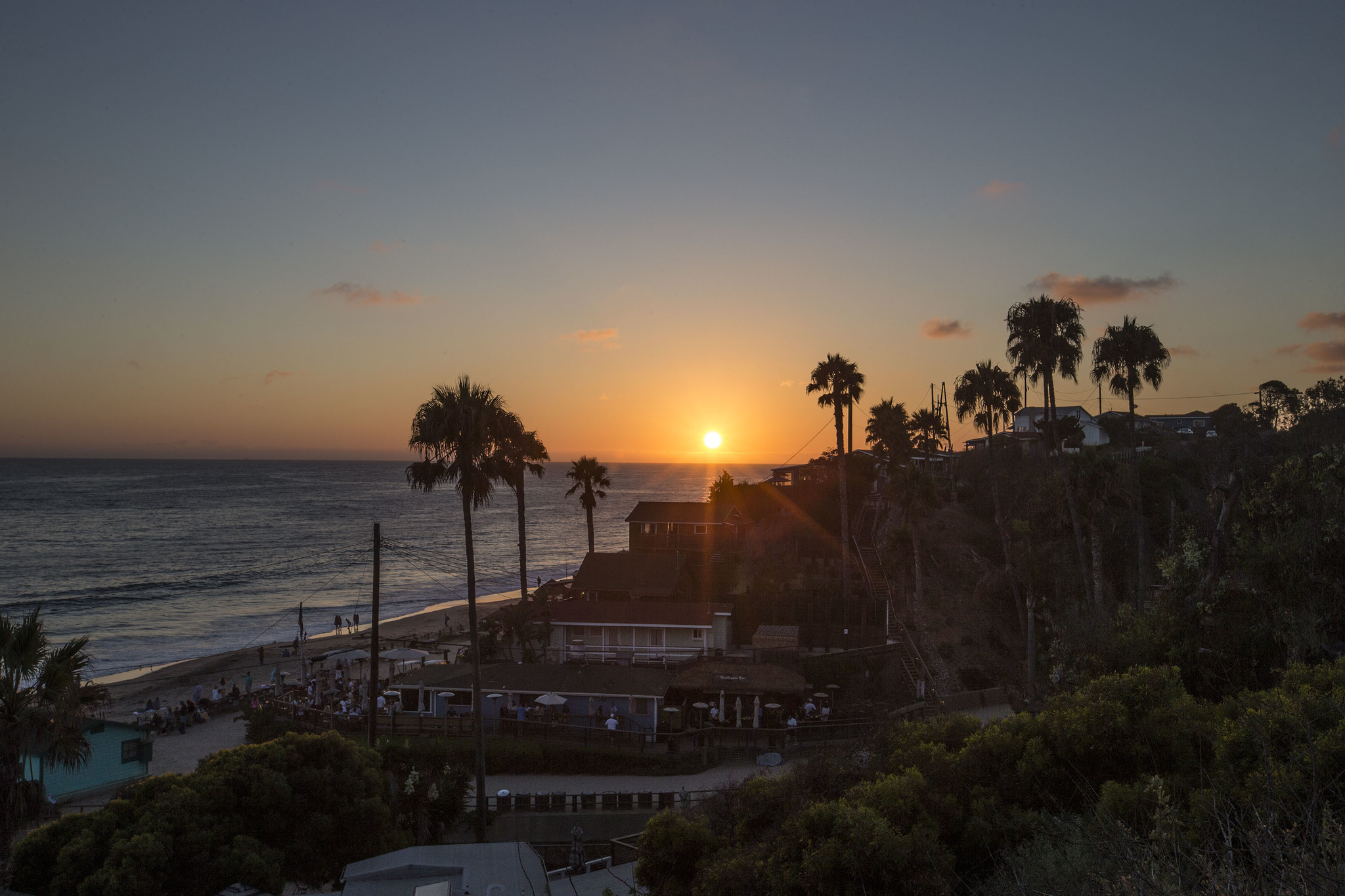 The sun sets over the Crystal Cove Beach Cottages in Newport Beach. (Allen J. Schaben / Los Angeles Times)