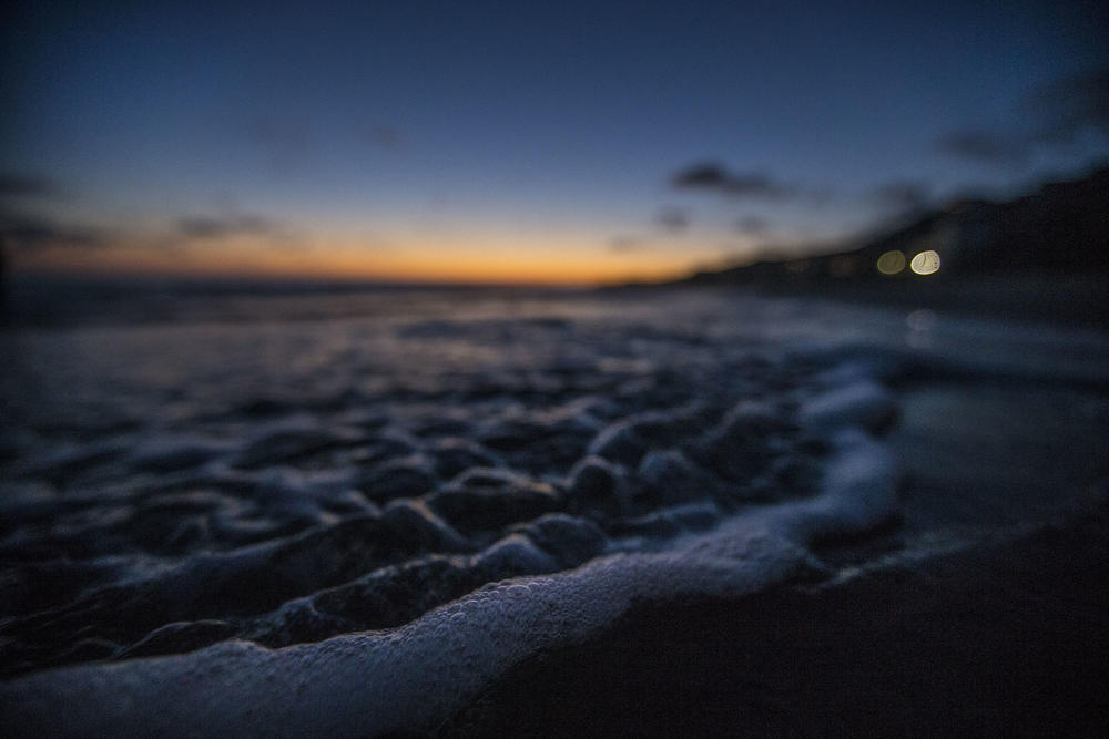 Incoming tide rolls onto the beach at twilight at Crystal Cove Beach Cottages. (Allen J. Schaben / Los Angeles Times)