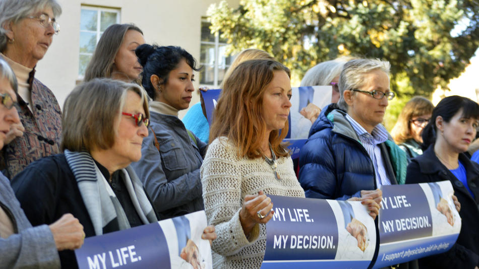 Right-to-die advocates rally in Santa Fe, N.M., in 2015. California's assisted suicide law took effect June 9.