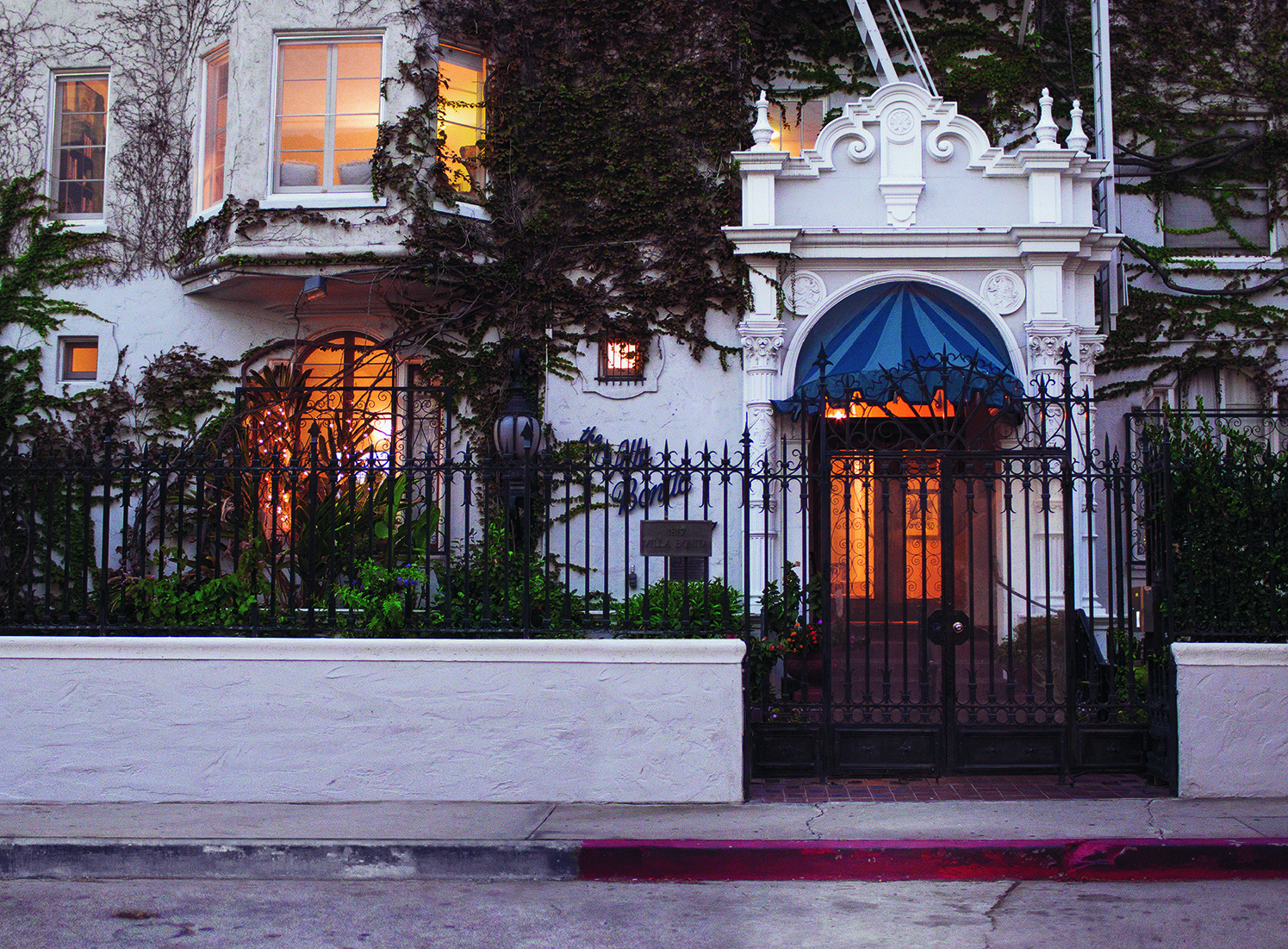 The entrance to Villa Bonita, built in the 1920s to house film cast and crew members, sits behind iron gates.