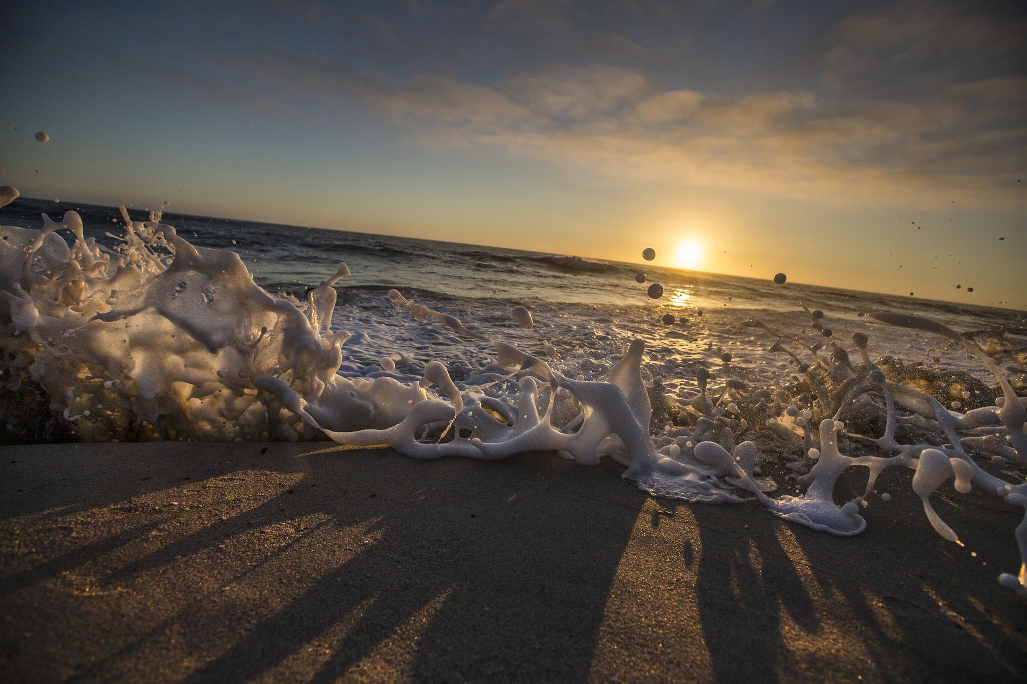 The tide splashes up on the beach at sunset on a warm summer evening at Windansea Beach in La Jolla. (Allen J. Schaben / Los Angeles Times)