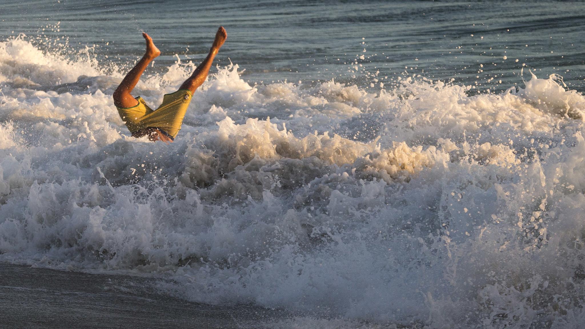 A body surfer is upended in the crashing surf at Windansea Beach in La Jolla. (Allen J. Schaben / Los Angeles Times)