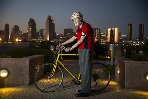 Former senator James Mills, 89, stands with the bike he rode from Sacramento to San Diego in 1972 to promote Prop 20, which created the Coastal Commission and led to the Coastal Act. The photo was taken overlooking the San Diego skyline from Mills' Coronado apartment Wednesday. (Allen J. Schaben / Los Angeles Times) None