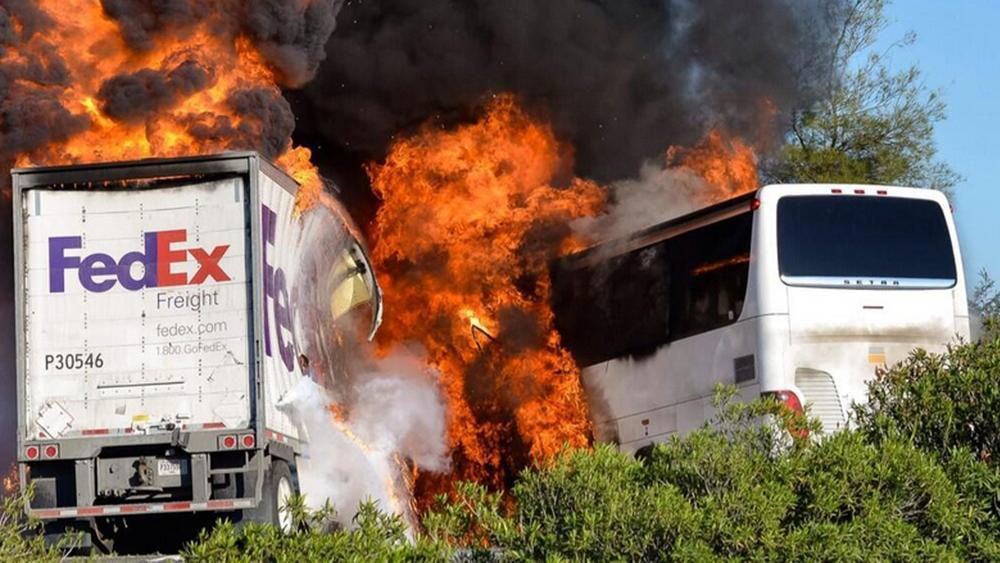 Flames erupt after a fatal 2014 crash near Orland involving a FedEx truck and a bus carrying Los Angeles-area high school students on a visit to a Northern California college. (Jeremy Lockett / Associated Press)