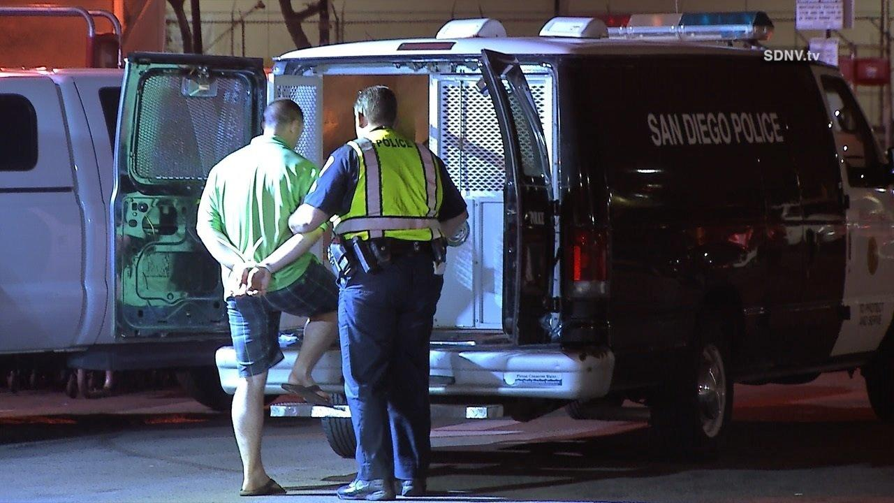 Police take a man into custody at a DUI checkpoint on St. Patrick's Day in downtown San Diego.