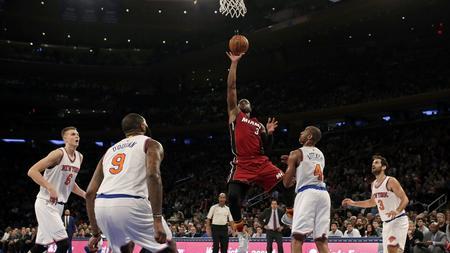 551747837 Miami Heat guard Dwyane Wade (3) drives to the basket past New York Knicks