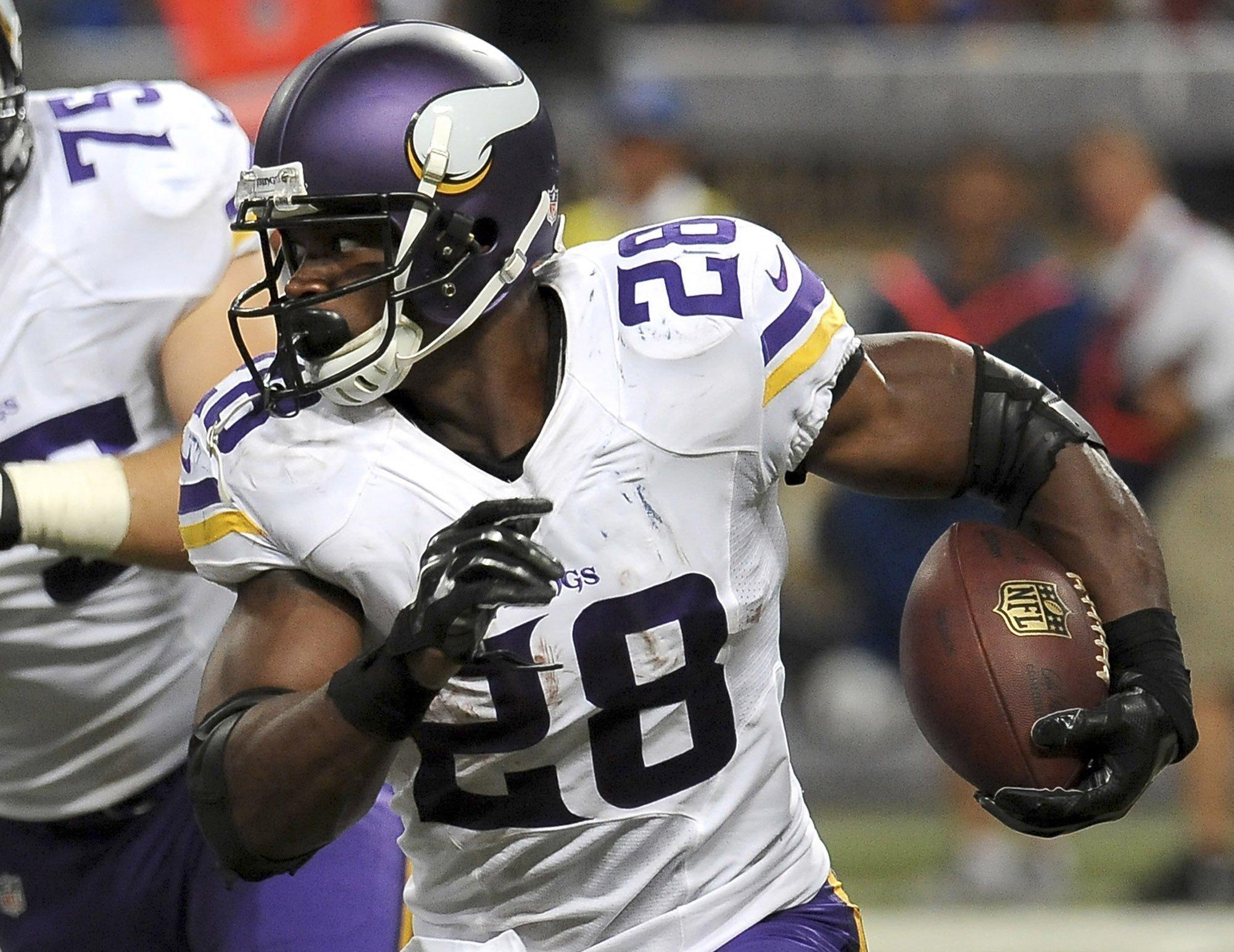 b44e58ec4 High hopes  Vikings finally pair Peterson with Bridgewater - The San Diego  Union-Tribune