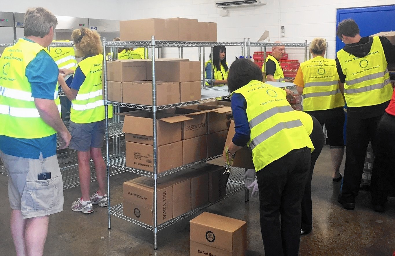 Volunteers Stock Shelves For District S First In School