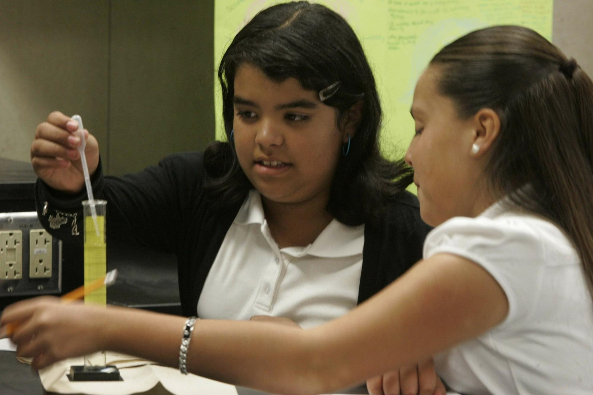 """Lorriana Mendez and Vivian Ortiz worked in science class at Castle Park Middle School. In the spring, 50 percent of the school's eighth-graders were rated """"proficient&#8221"""