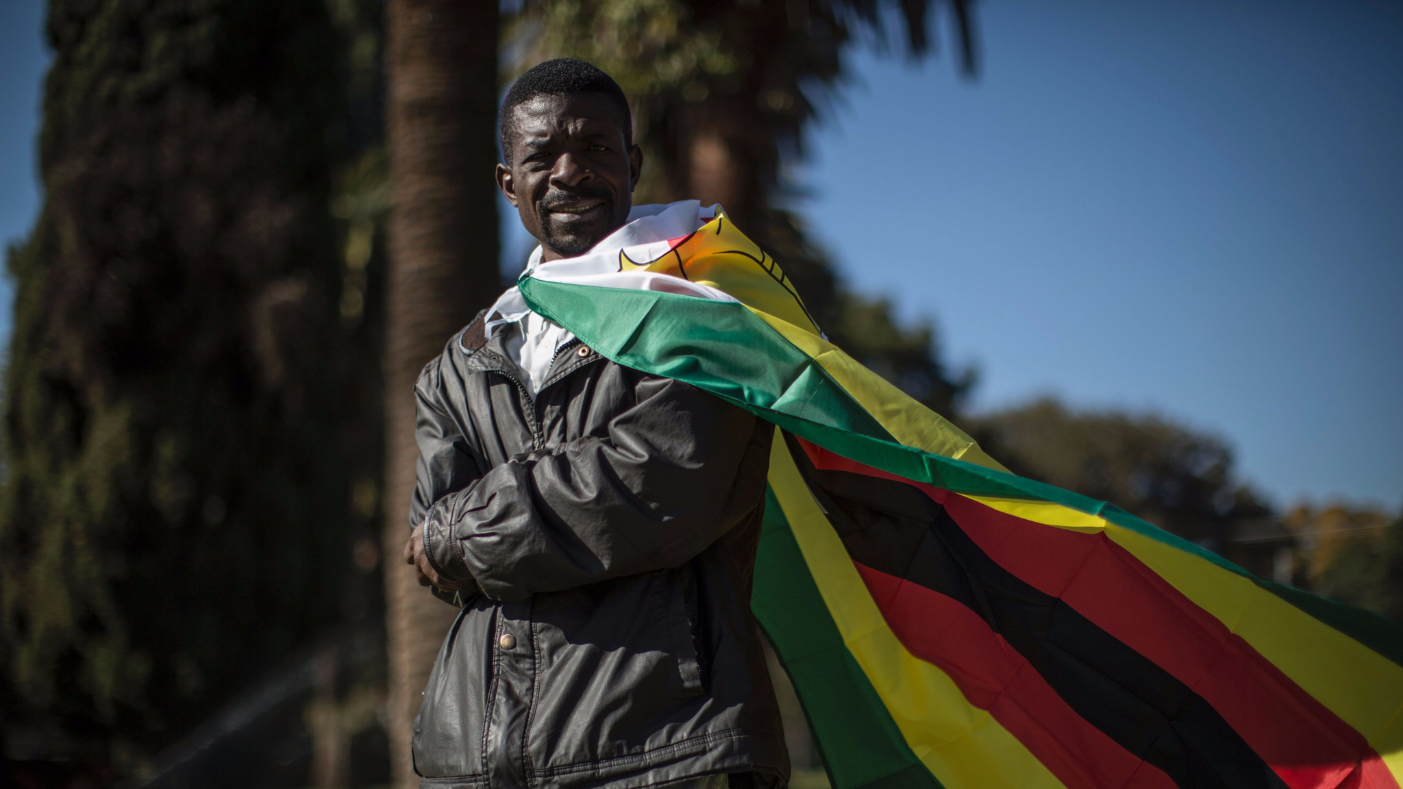 A #ThisFlag activist in Pretoria, South Africa, on July 14, 2016, during a march to the Zimbabwean Embassy.