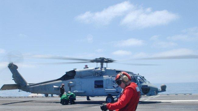 A Helicopter From The HSM 77 Squadron Prepares To Lift Off Flight Deck Navy Photo