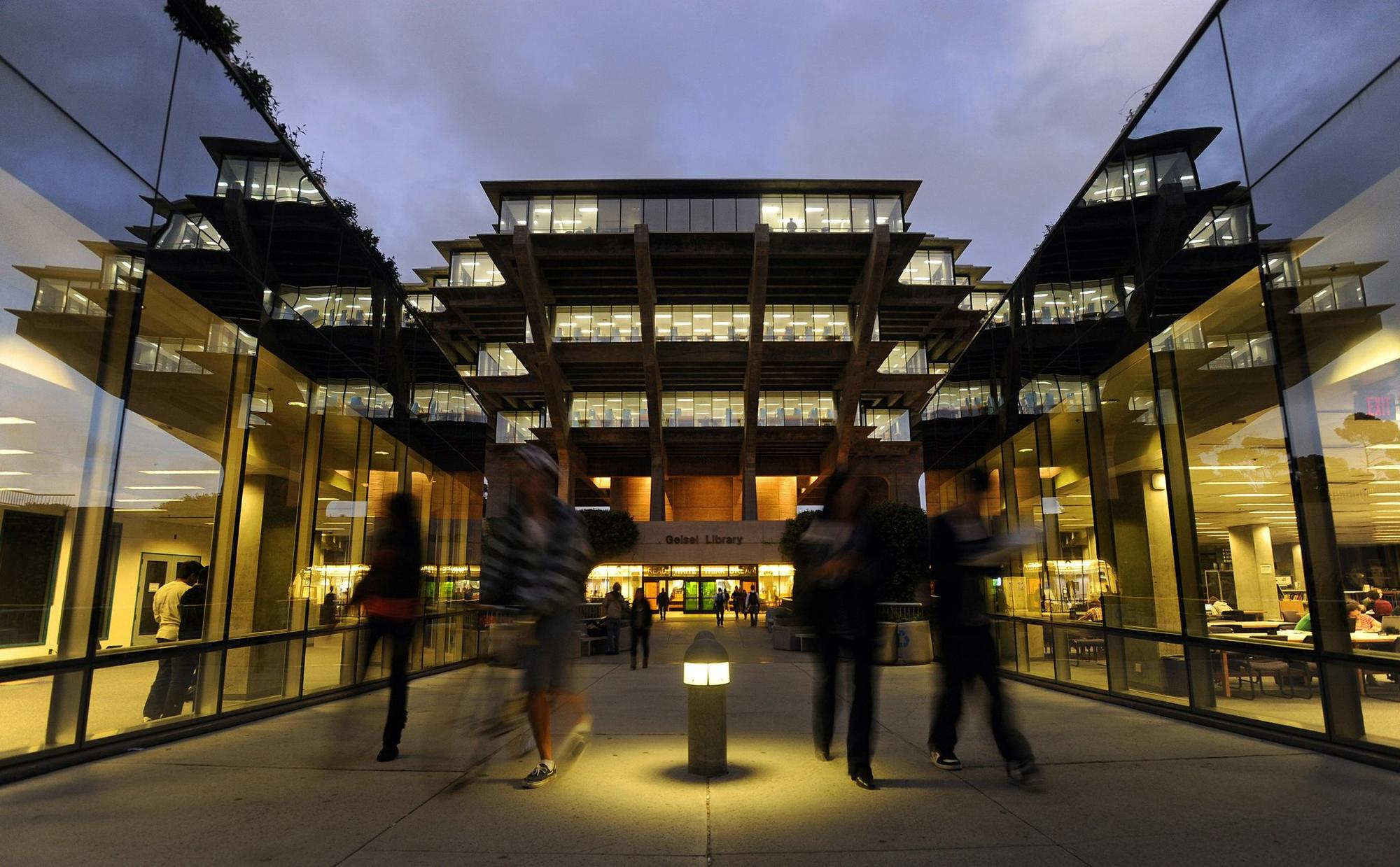 Students walk out of the Geisel Library at the University of California San Diego.