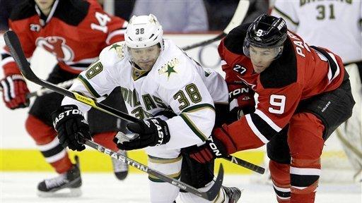 87b50512c Dallas Stars  Vernon Fiddler (38) competes for the puck with New Jersey  Devils
