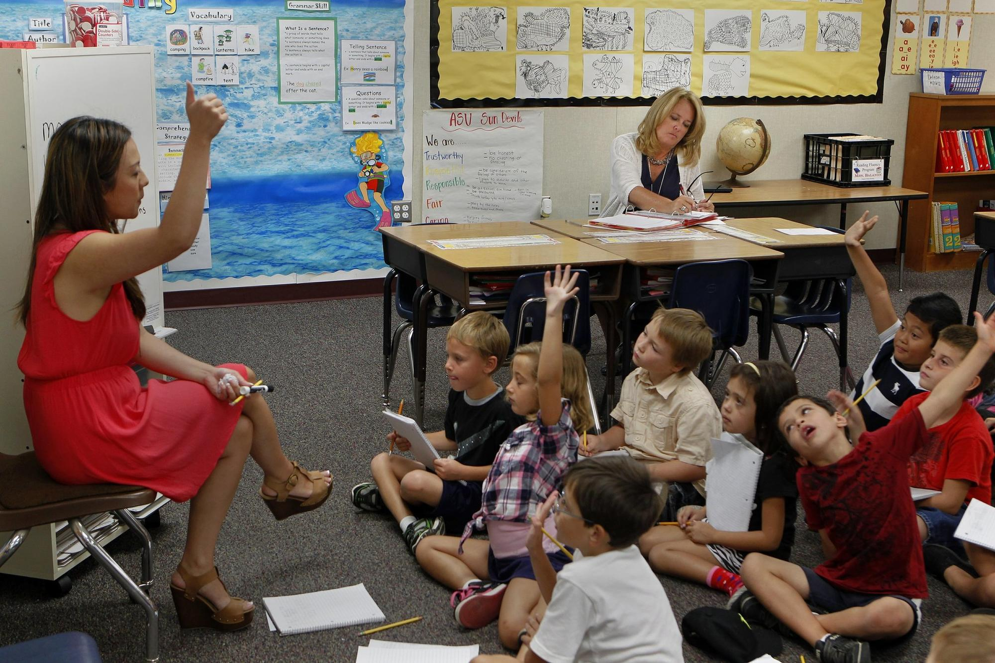 Teacher consultant Michele Manos (right) evaluates Kimberley De Leon's (left) 2nd grade class on Monday at Valley Elementary School in Poway, California.