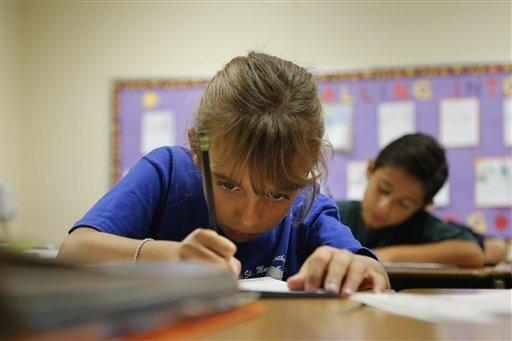 Alexia Herrera practices writing in cursive at St. Mark's Lutheran School in Hacienda Heights, Calif., Thursday, Oct. 18, 2012. Bucking a growing trend of eliminating cursive fro