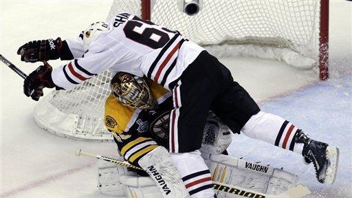1d23b7ad669 Chicago Blackhawks center Andrew Shaw (65) collides with Boston Bruins  goalie Tuukka Rask