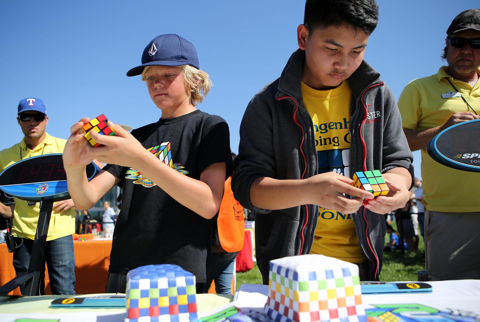 Alex Branch and Josh Pasco concentrate as they take part in a Rubik's Cube competition at Super STEM Saturday at California State University San Marcos.