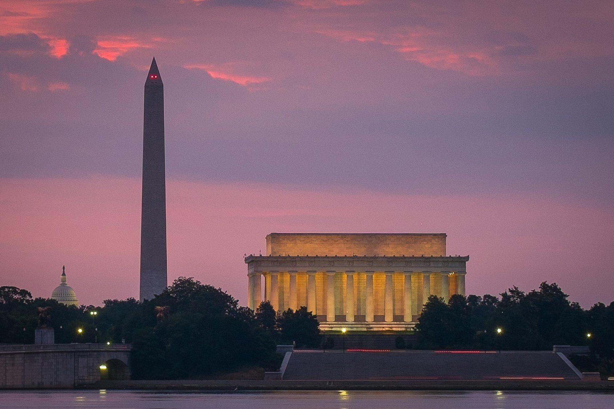 FILE - This June 21, 2014 shows sunrise over, from left, the Capitol Dome, Washington Monument and Lincoln Memorial in Washington. A federal appeals court has ruled in favor of t