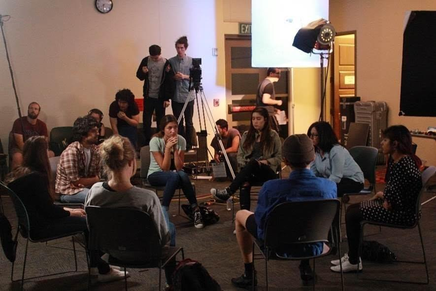 Crew members shoot a scene depicting a support group for sexual assault survivors for the short SDSU student film