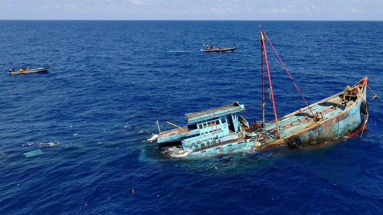 Illegal fishing vessels are sunk by Indonesian authorities in the waters near the country's Natuna Islands in August 2016.