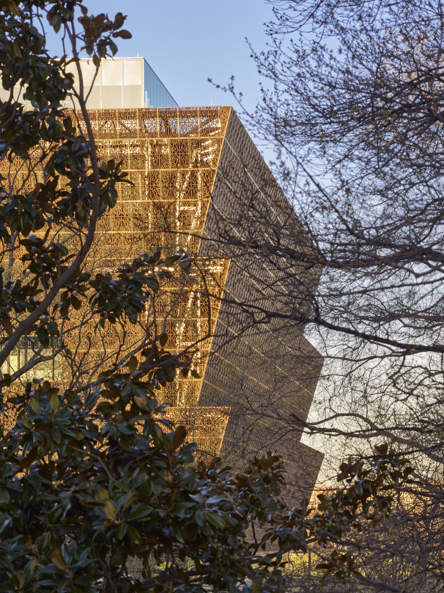 The panels wrapping the exterior of the museum are inspired by ironwork created by American slaves.