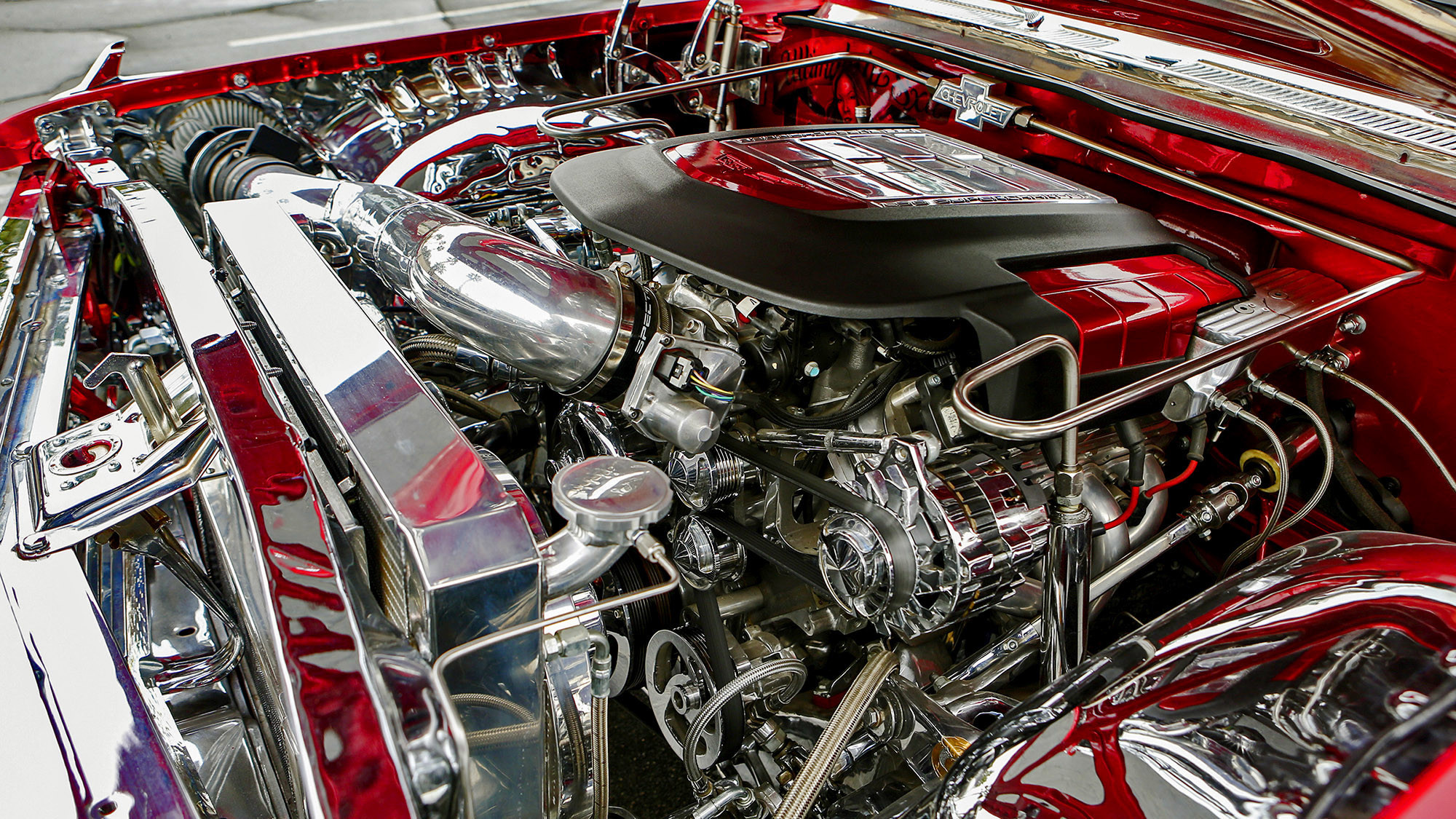 A look under the hood of Vernon Maxwell's 1961 Chevy Impala lowrider reveals a supercharged engine.