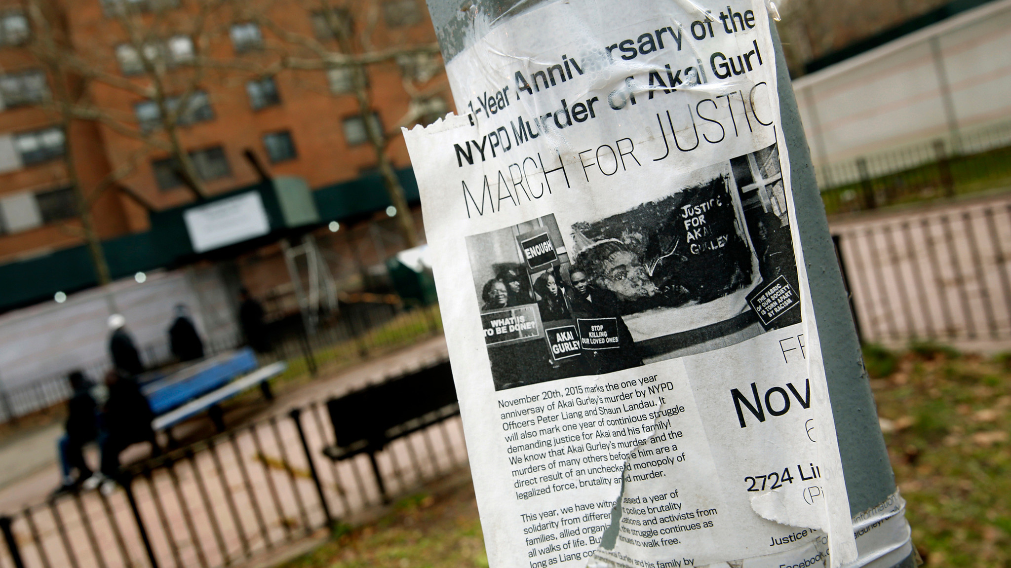 A poster in New York announces a protest march a year after the shooting death of Akai Gurley.