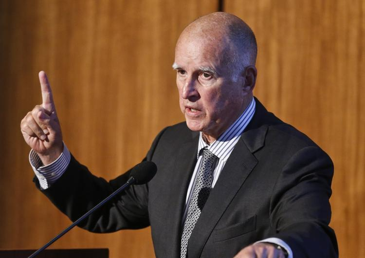 Gov. Jerry Brown allowed a bill to become law Friday without his signature. (Lenny Ignelzi / Associated Press)