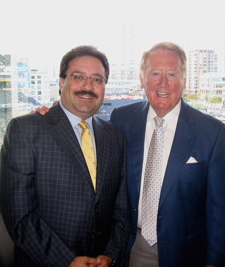 Michael Horowicz poses with Vin Scully in the broadcaster's booth in San Diego.