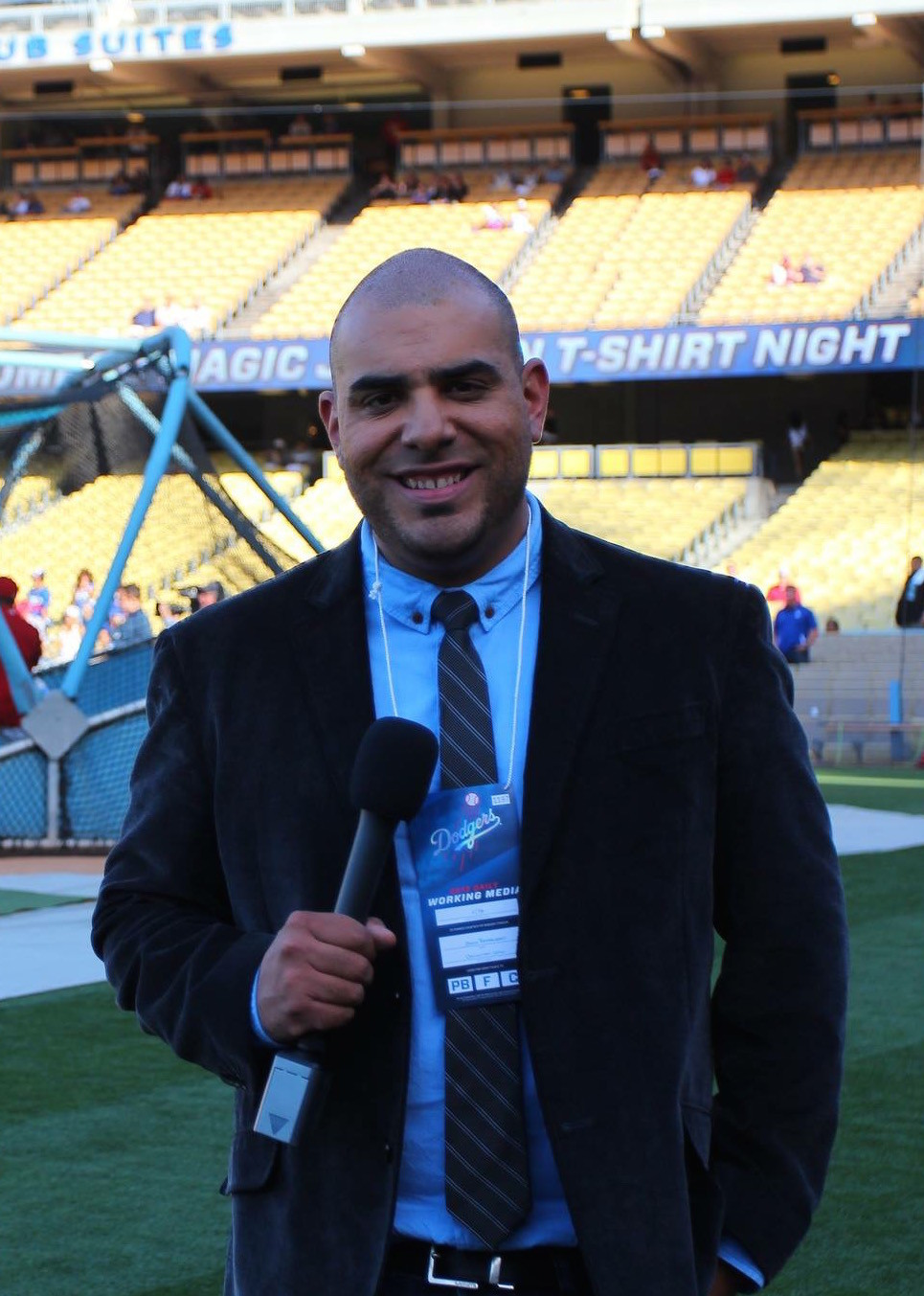 Jason Barquero covers a Dodgers game as a freelance reporter in 2013.