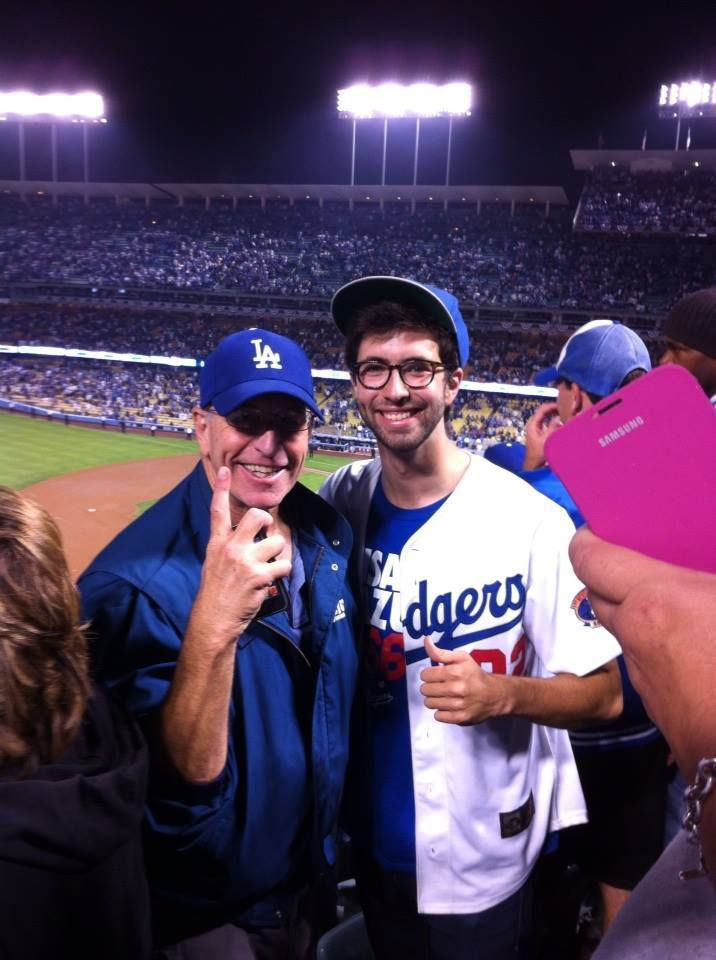 Julian Rubel smiles with his father at a Dodgers game in 2013.