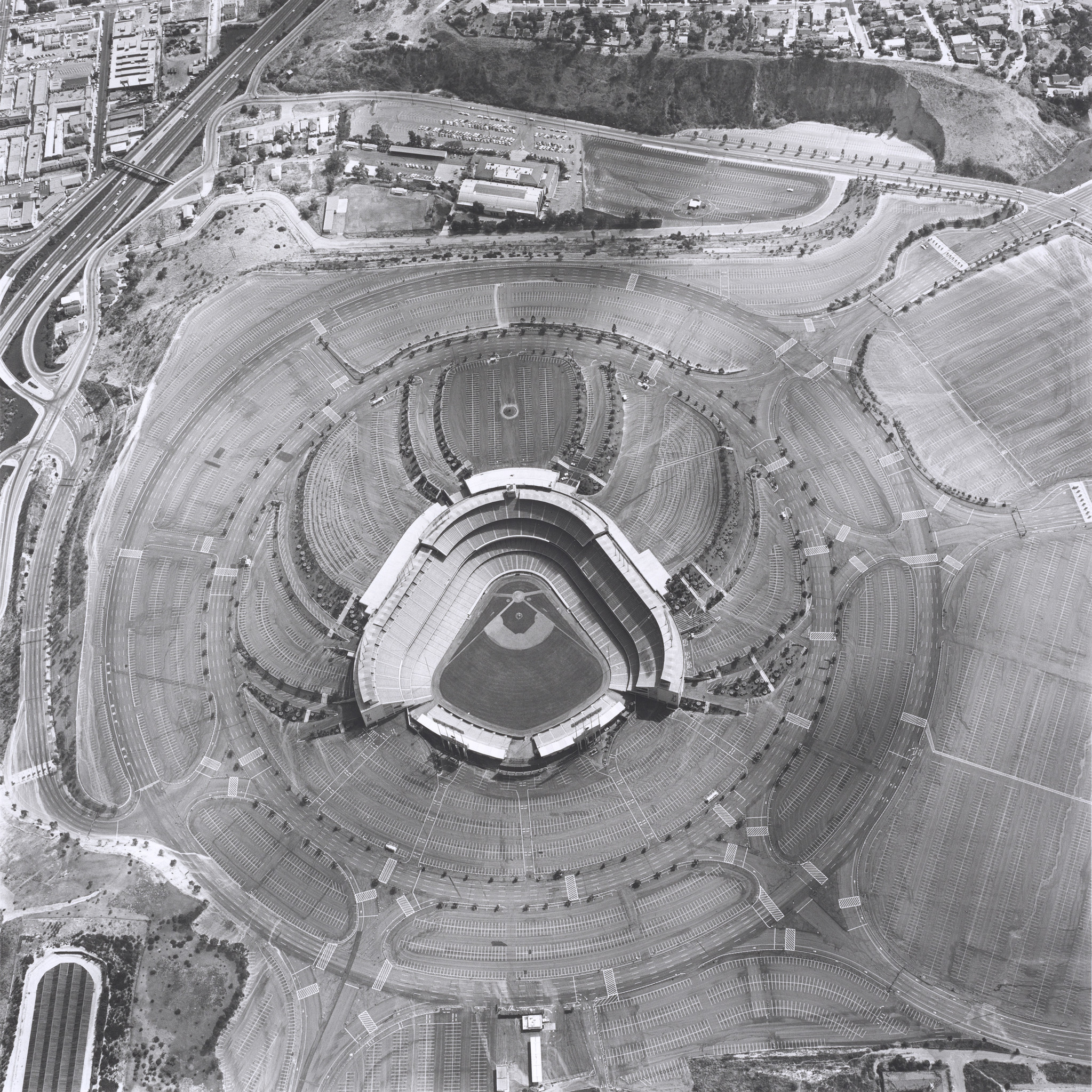 "Ed Ruscha's ""Dodger Stadium, "" 1000 Elysian Park Ave., 1967, from ""Parking Lots,"" series published in 1999."