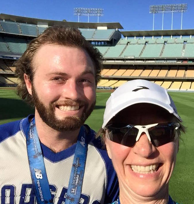 Benjamin David Hillman poses with his mother, Nadia Lindstrom Hillman, after completing the Dodgers 10K run.