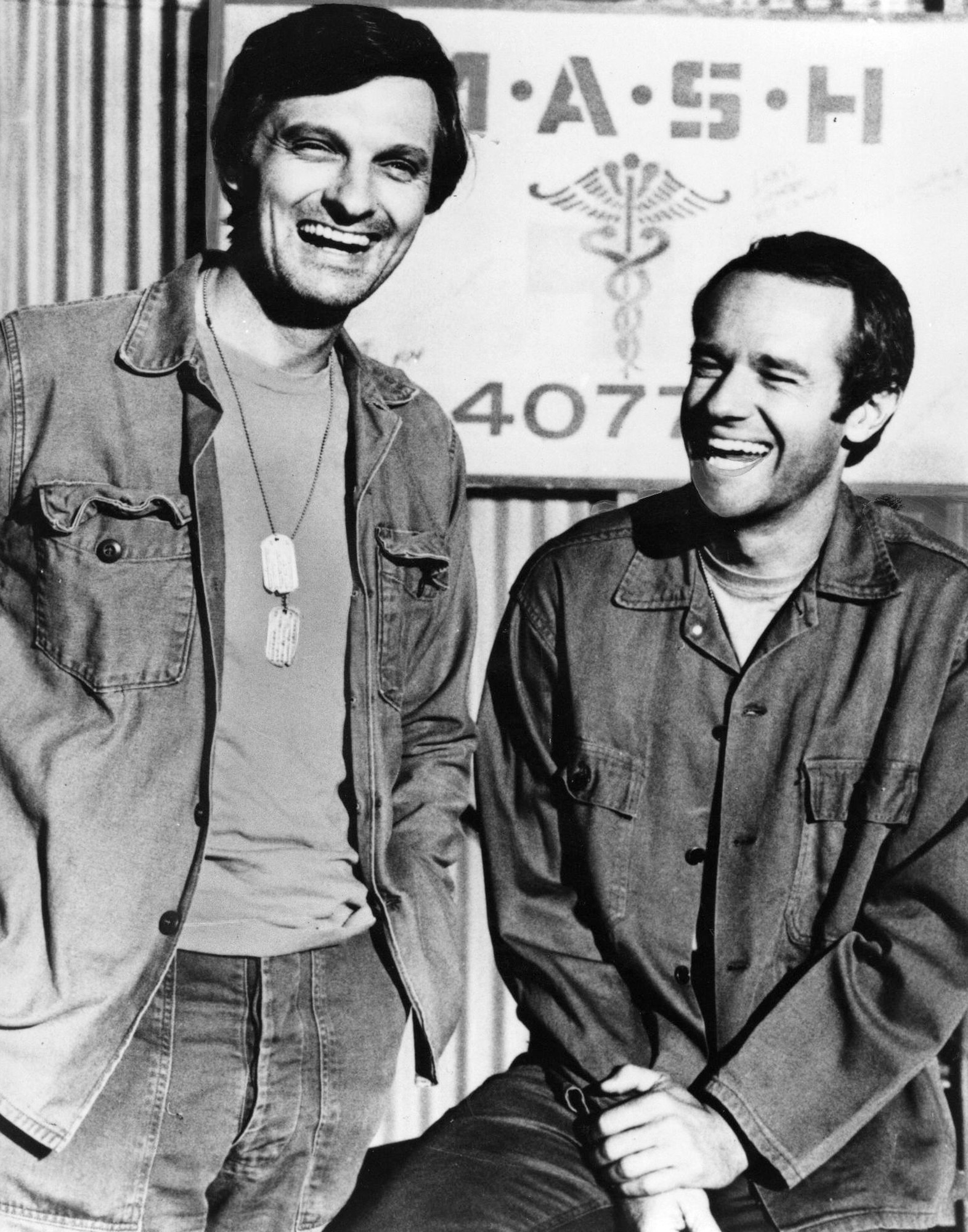 """Alan Alda, left, and Mike Farrell in the TV program """"MASH."""""""