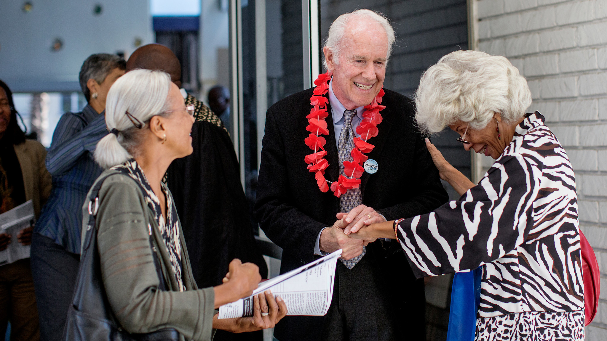 Actor Mike Farrell greets parishioners after speaking in support of Prop 62 at the Holman United Methodist Church.