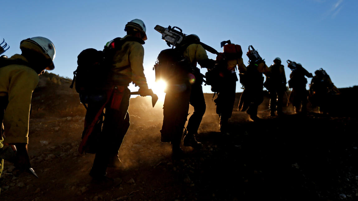 U.S. Forest Service hotshots hike back to a lookout tower after battling the Soberanes fire in Los Padres National Forest in Monterey County last summer.