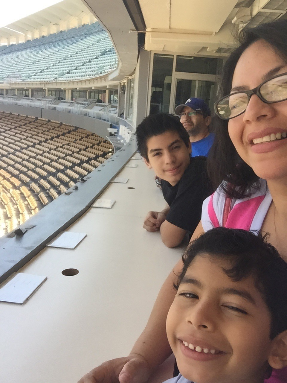 Jose Becerra, top, with his wife Maria Vallejo-Becerra and their two sons, Joshua and Julian, celebrating his 49th birthday with a stadium tour.