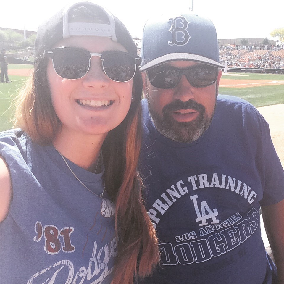 Michael Lennon with his daugther, Emily Lennon, catching the Dodgers' last spring training game in Arizona this past March.