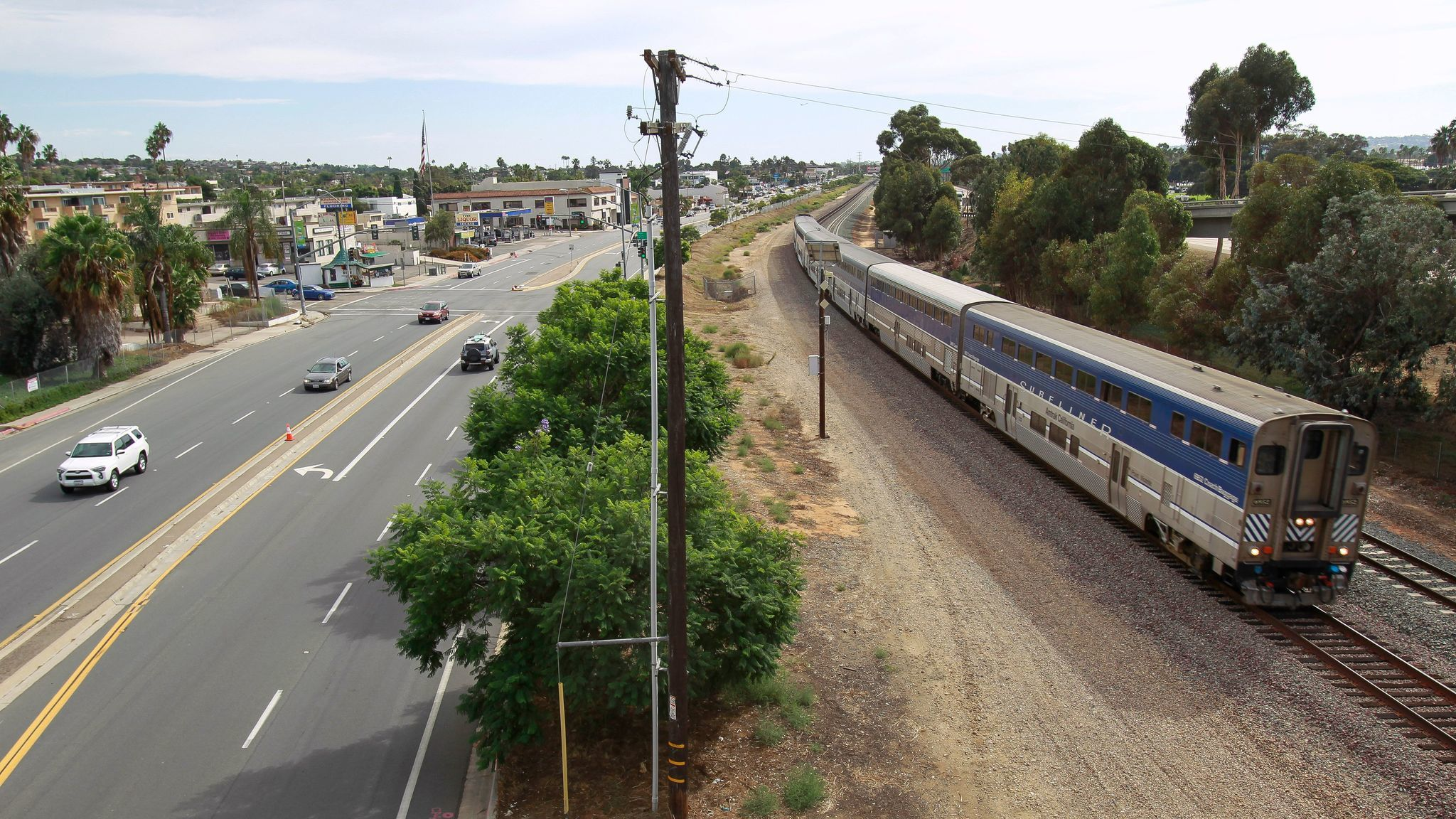 A train moved north on Sept. 27, 2016 past the site of the future Clairemont Drive Station for the trolley extension.