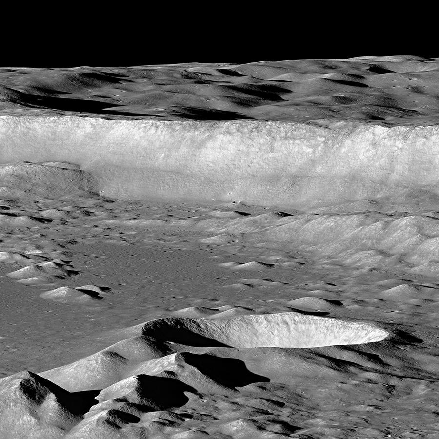 Floor and eastern wall of Antoniadi crater, on the moon.