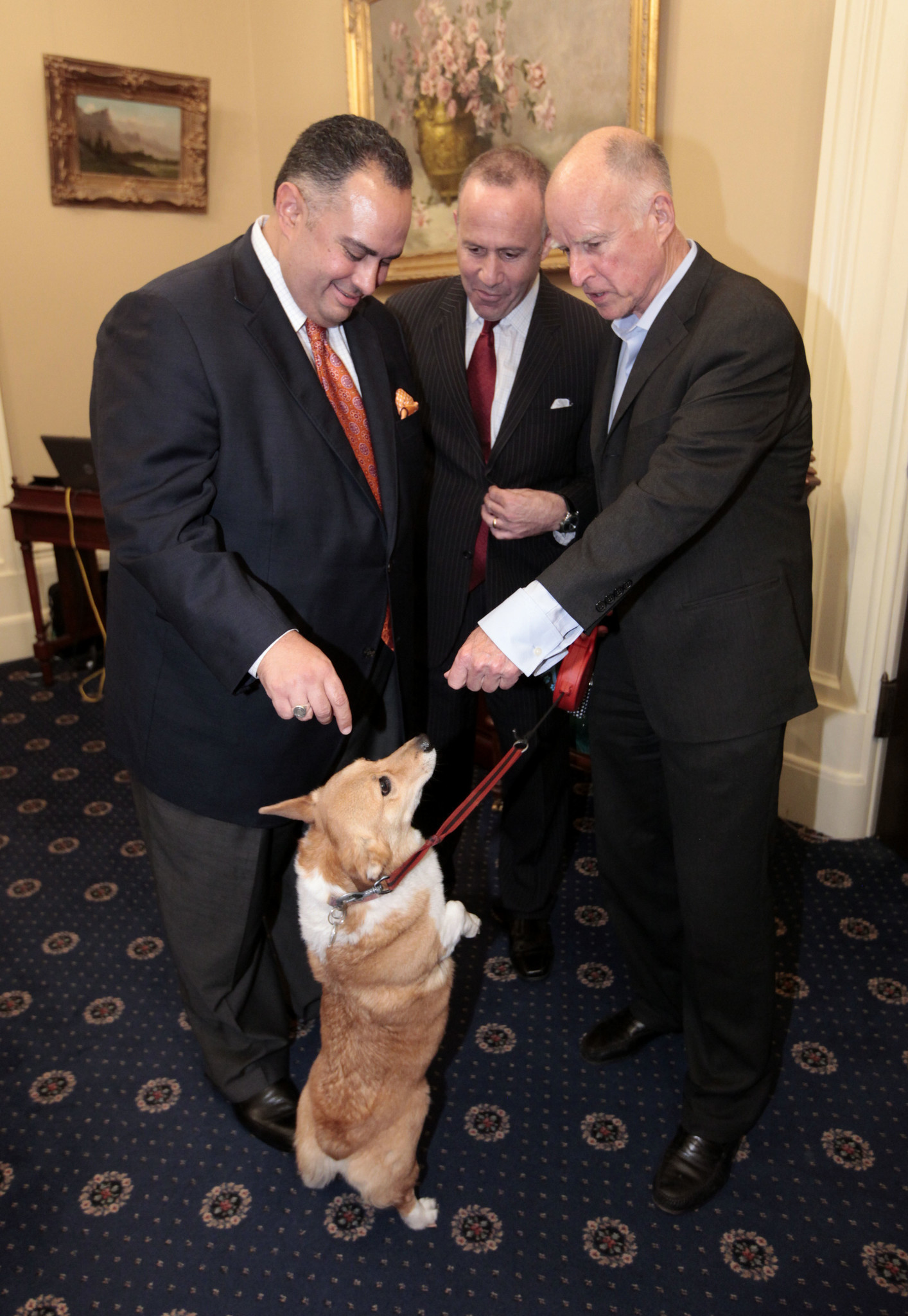 Gov. Jerry Brown, right, shows off Sutter during a 2012 meeting with Assembly Speaker John Perez (D-Los Angeles), left, and Senate President Pro Tem Darrell Steinberg (D-Sacramento).