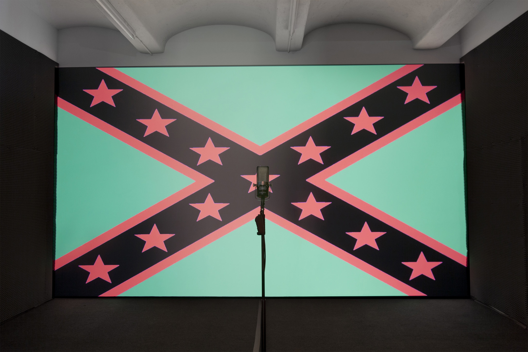 In a still from Black Righteous Space, a 2012 multimedia work by Hank Willis Thomas, the Confederate flag is recast using colors associated with the Pan-African flag.
