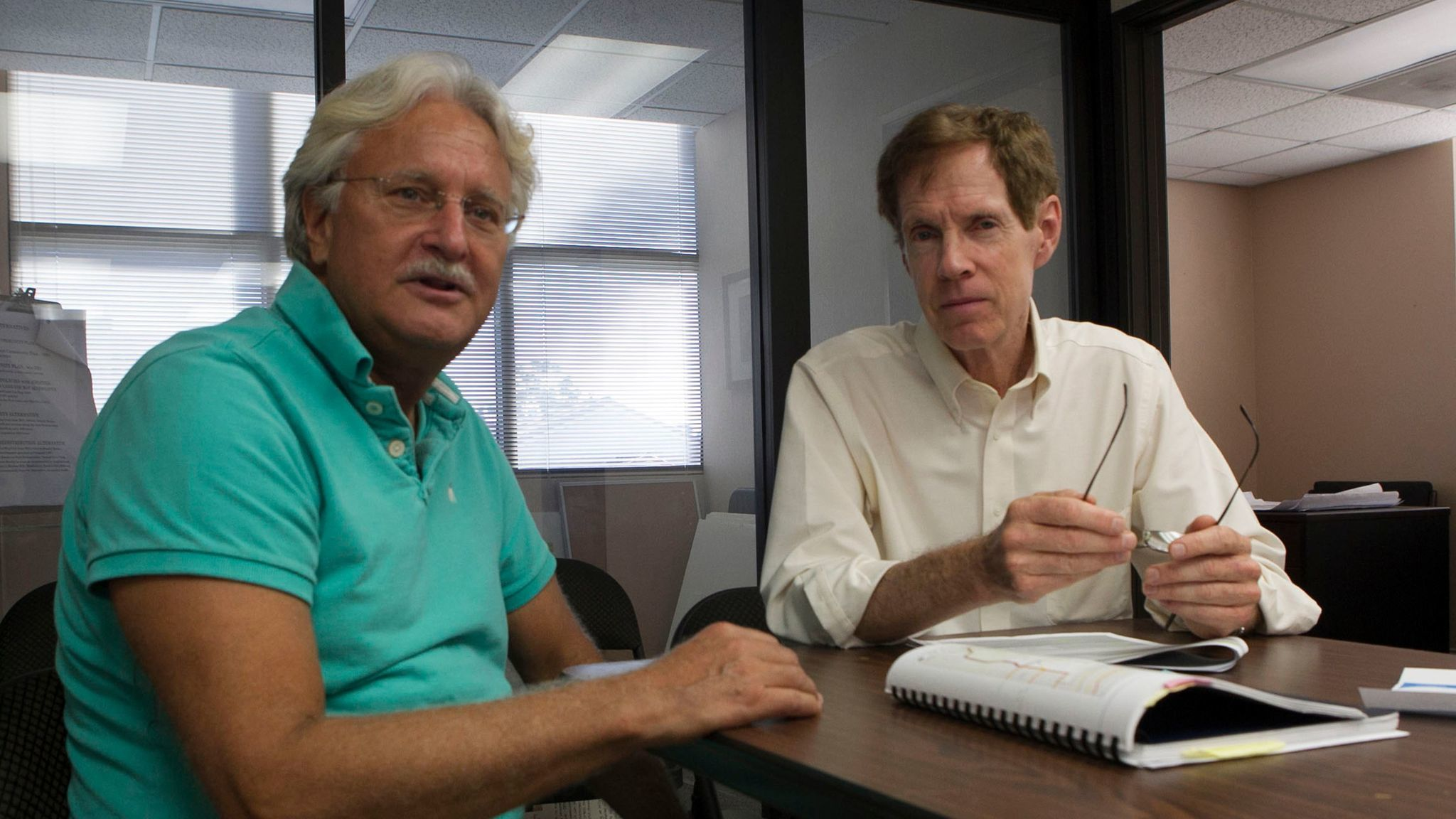 Uptown United founder Tom Mullaney and Roy Dahl in the group's office.