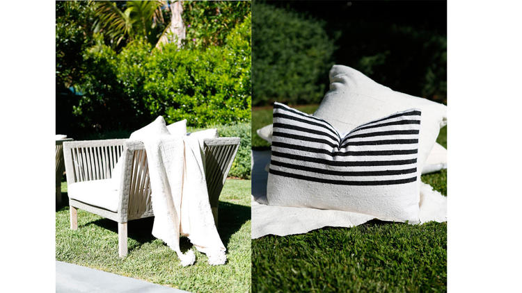 Mud cloth pom pom throw, $225 and pillows, $295.