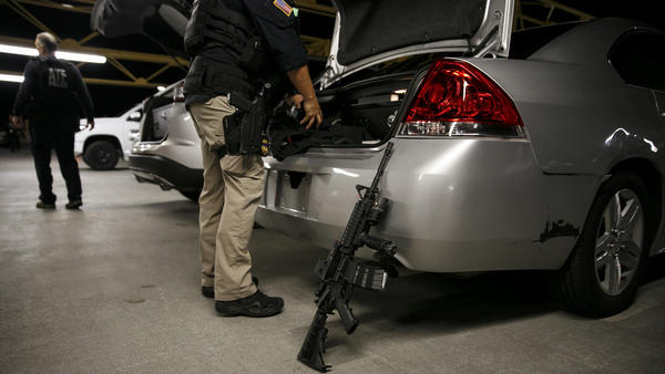 ATF agents gear up at their staging area before conducting raids for illegal guns in the San Fernando Valley on Nov. 2, 2016.