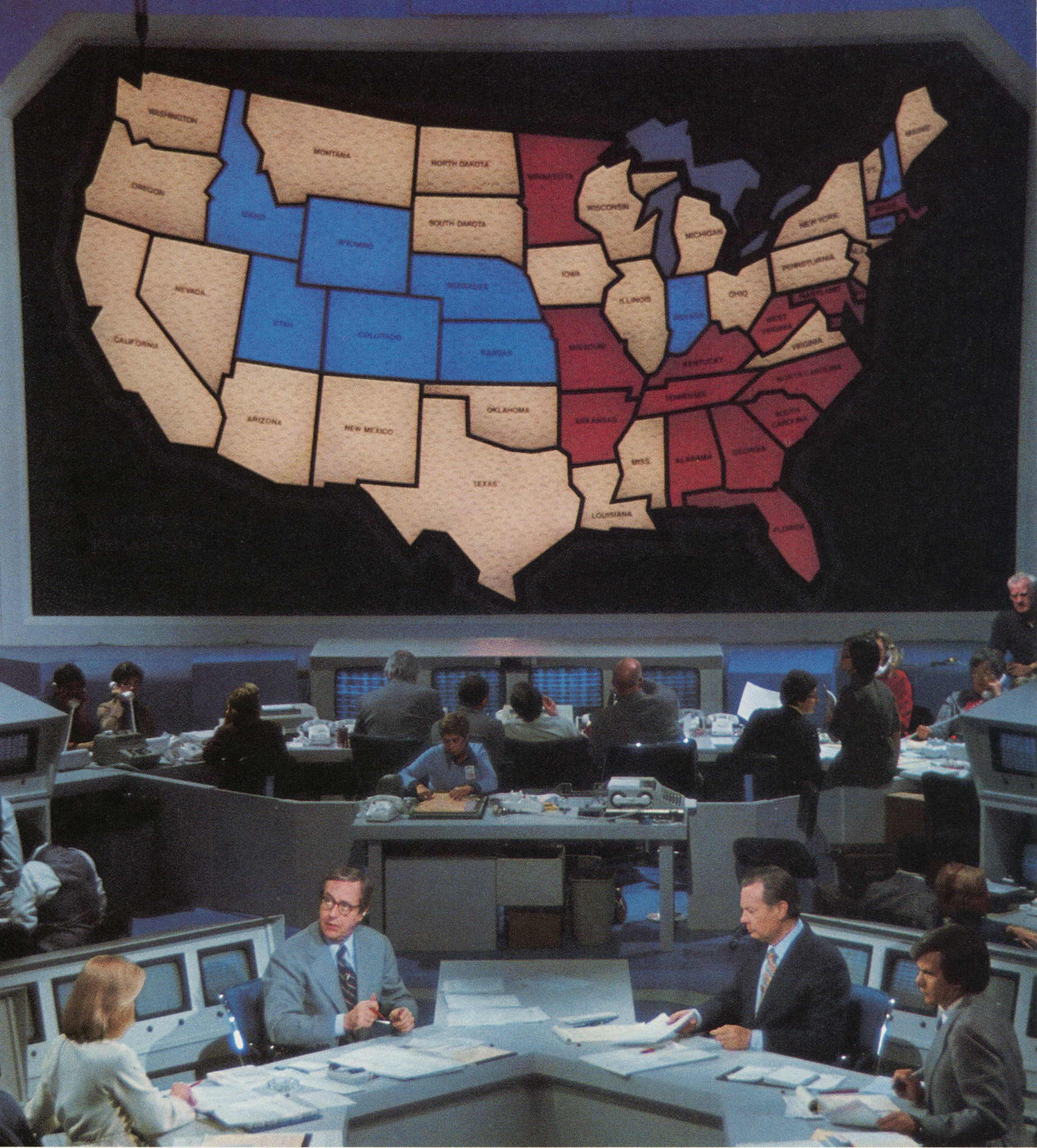 The original NBC electoral map, first seen on Nov. 2, 1976. Pictured, from left, Cassie Mackin, John Chancellor, David Brinkley, and Tom Brokaw.