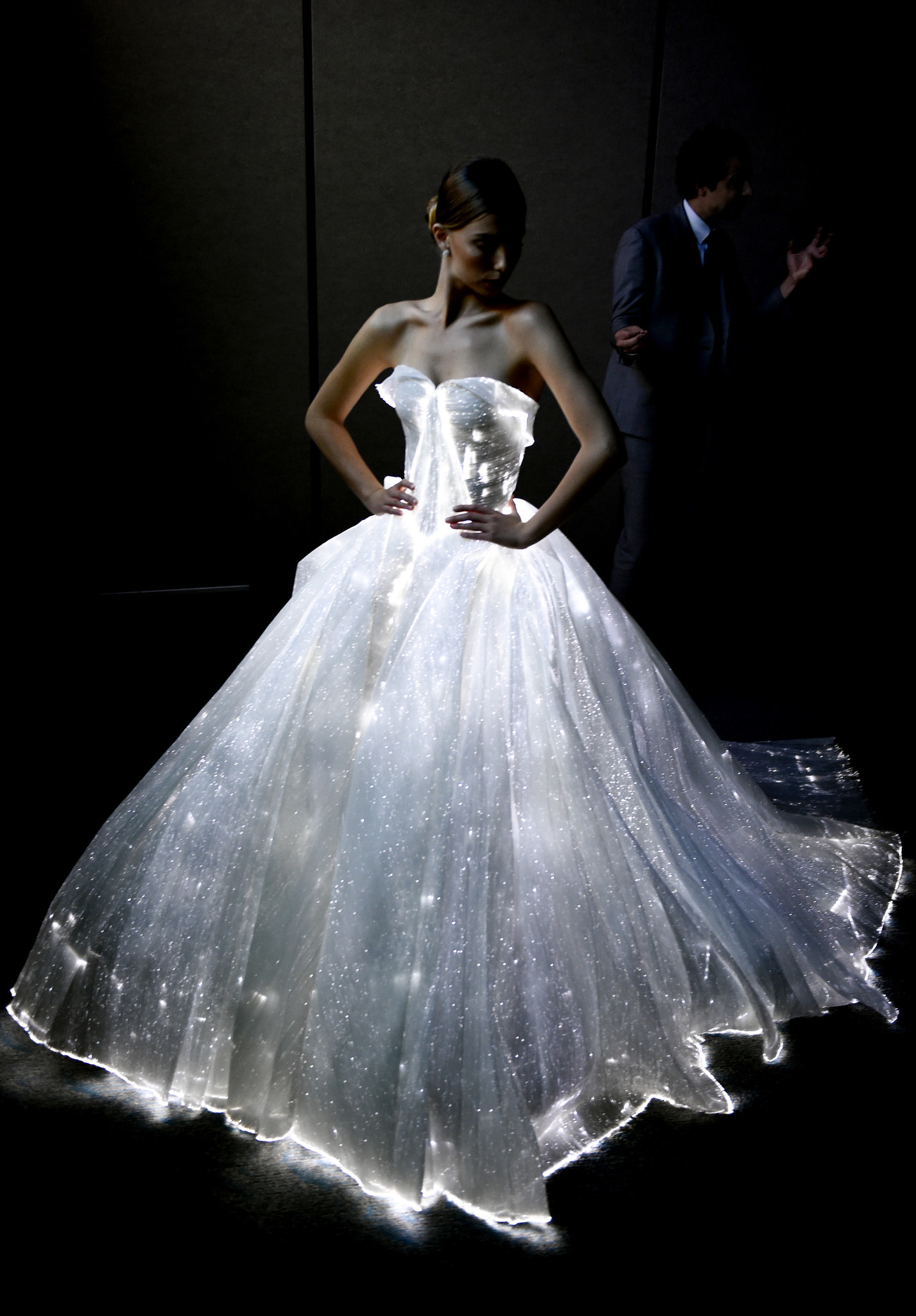 IMAGE DISTRIBUTED FOR ADOBE - Fashion designer Zac Posen talks with the press while showing off his light-up, fiber optic dress at Adobe MAX, The Creativity Conference, on Thursday, Nov. 3 , 2016 in San Diego. (Denis Poroy/AP Images for Adobe)