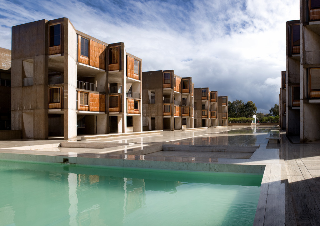 The view east, revealing the buildings' teak elements, sawtooth design and reflecting pool.