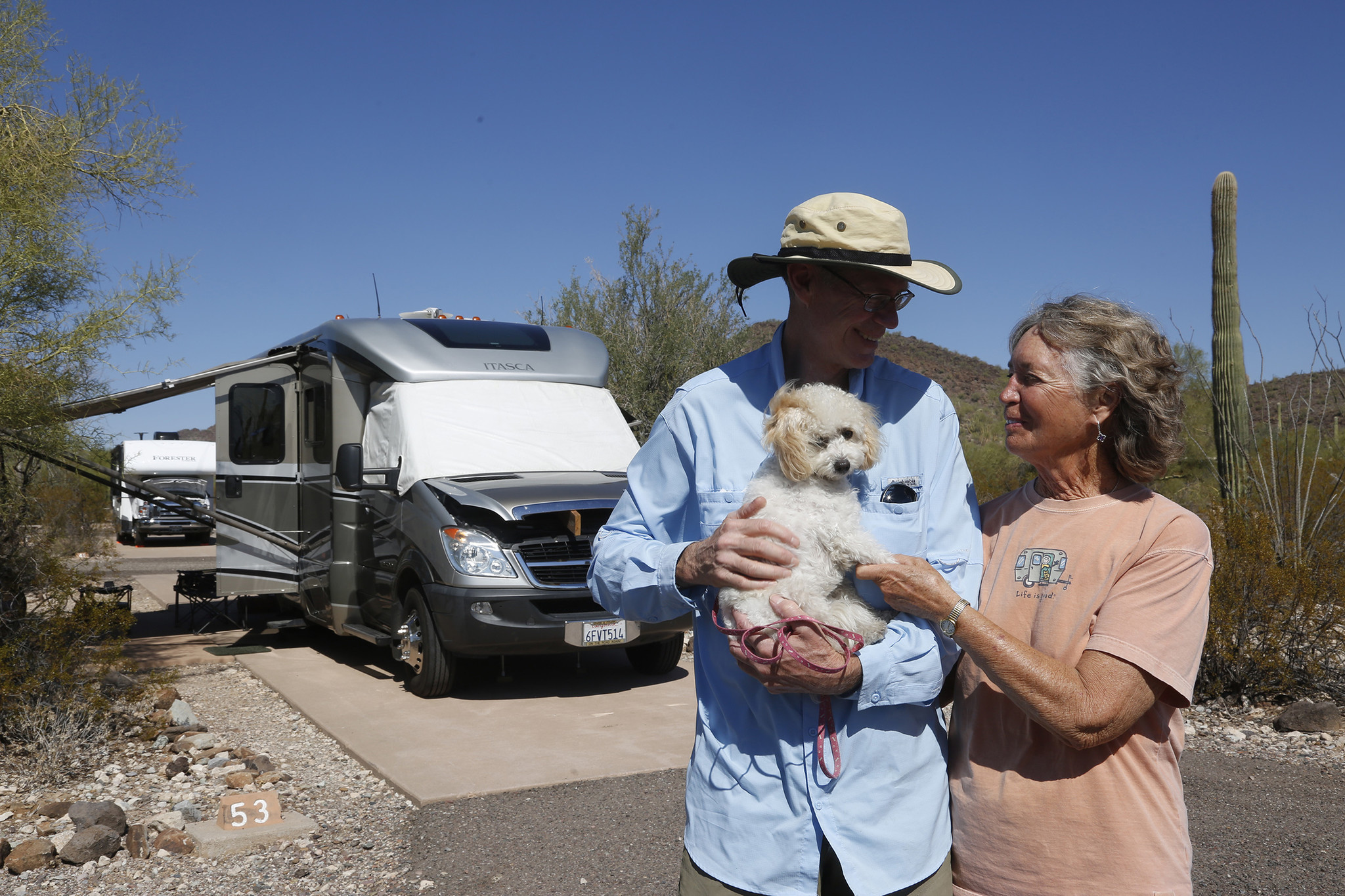 San Diego residents Frank Yancey and Barbara Deese stand with their dog Sophie at a campground at Organ Pipe National Monument.
