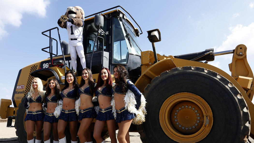Rams cheerleaders and mascot attend a groundbreaking ceremony for the team's new stadium in Inglewood on Nov. 17, 2016.